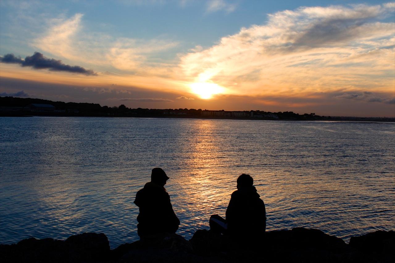 Sea dawn sunset couple